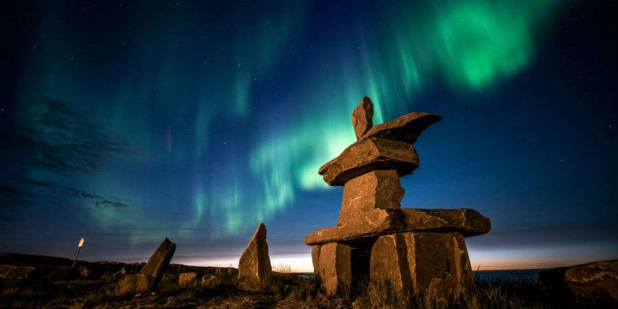About Section Header - Inukshuk, Aurora Borealis